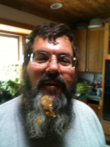 Charles Hudacko with honeycomb stuck in his beard.